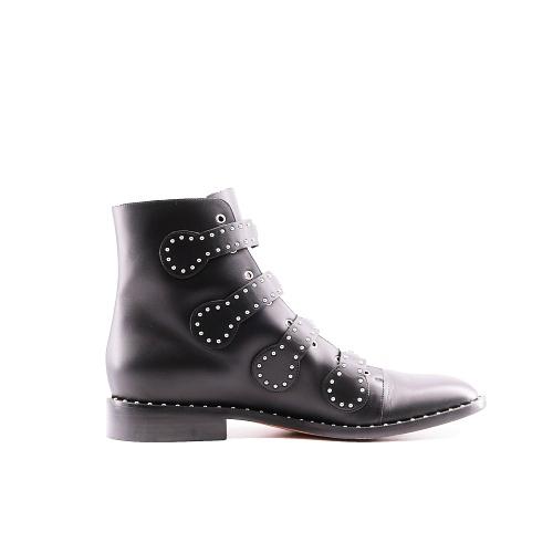 Bottines Givenchy cuir noir cloutées côté